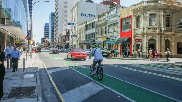 Greening bike lanes helps to provide a degree of separation between cars and bikes, and visually narrow a street environment